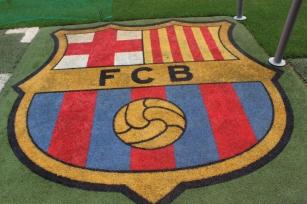 FC Barcelona Logo on the Pitch
